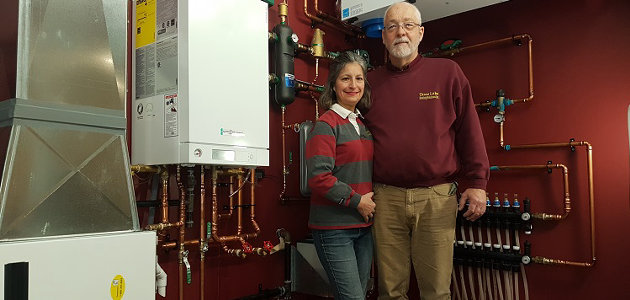 Elizabeth and Jan Sirek in the display room at Tasso Lake Heating Solutions (supplied)