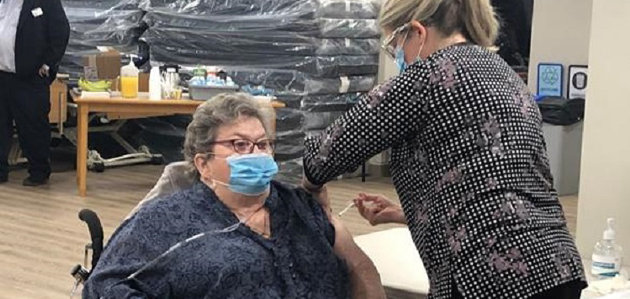 Eighty-year-old Pat Sinclair, a former nurse, became the region's first long-term care resident to receive the COVID-19 vaccine on Monday at Barrie's Victoria Village Manor. (supplied)
