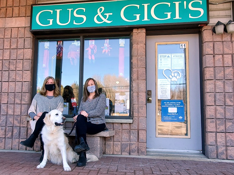 Gus & Gigi's owner Tara Kerr (left) and Jody Wright with Lily