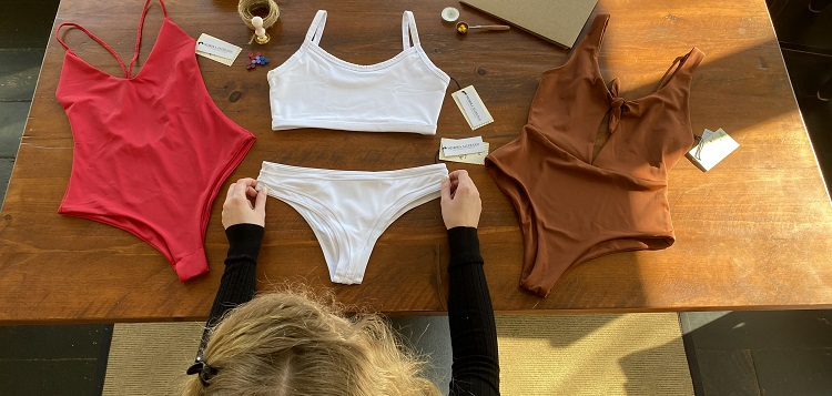 As an entrepreneur, Emily Crowder performs almost every task in her new business, including packaging swimsuits (supplied)