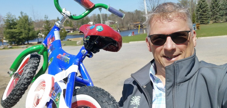 David McLean with one of the bikes given away to local families (submitted photo)