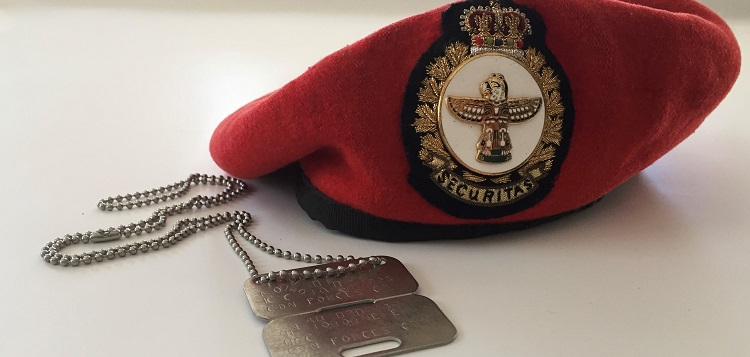 Nancy Osborne's beret and dog tags from her military service (submitted)